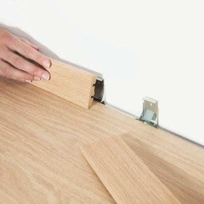 Quick Step - Système de clipsage pour plinthes standard